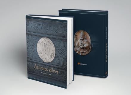 Vormgeving en opmaak, in opdracht van Provincie Oost-Vlaanderen, van het boek 'Aalsters Zilver', geschreven door Jozef Dauwe.